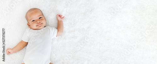 Fotografie, Obraz Portrait newborn baby happy over white background, topview
