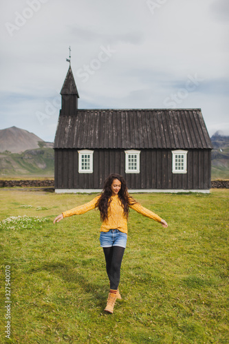 Fotografija Portrait of young happy woman in orange sweater, jeans shorts and black leggings
