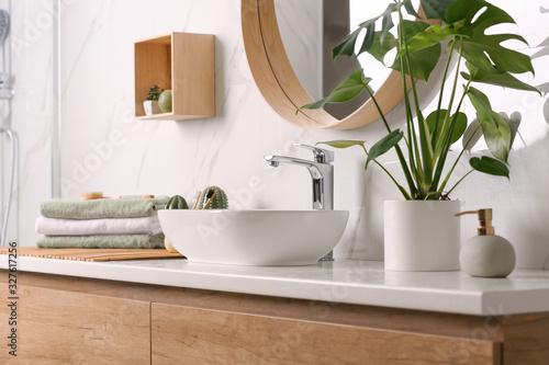 Leinwand Poster Stylish vessel sink on light countertop in modern bathroom