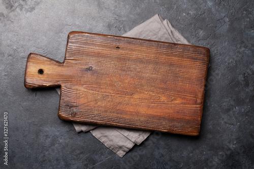 Cuadros en Lienzo Cutting board over towel on stone kitchen table