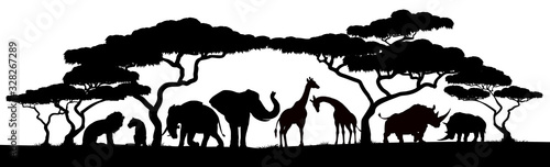 Photo African safari animals and trees in silhouettes scene