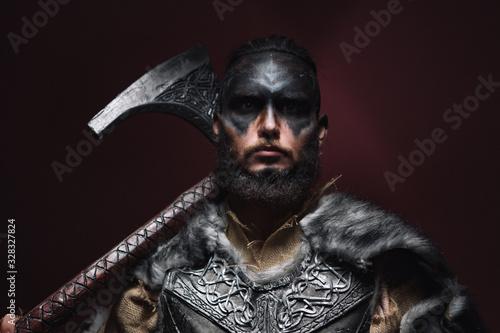 Fototapeta portrait of a Viking man with an axe