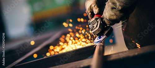 Fotografia, Obraz Heavy industry worker with grinder