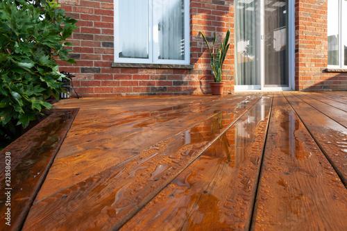 Fotografiet Backyard wooden deck floor boards with fresh brown stain