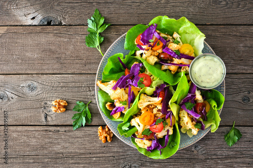 Canvas Print Healthy lettuce wraps with grilled cauliflower, cabbage and tomatoes