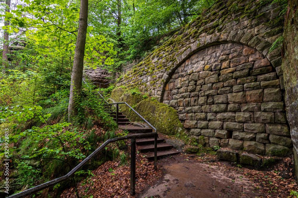 Stairs and a stone wall up to the famous Bastei bridge in Saxon Switzerland <span>plik: #329923813 | autor: Asvolas</span>