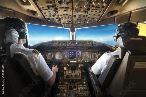 Obraz na płótnie Rear View Of Pilots Sitting In Cockpit