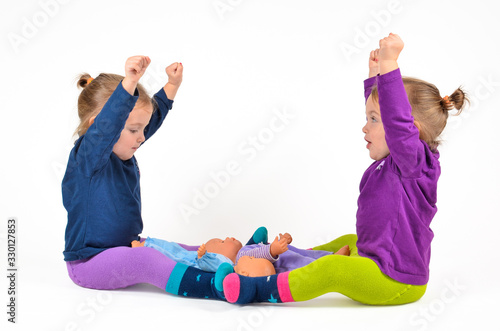 Valokuva Happy Twin Baby Girls Playing With Dolls Against White Background