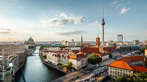 Photo Berlin skyline panorama with TV tower and Spree river at sunset, Berlin, Germany