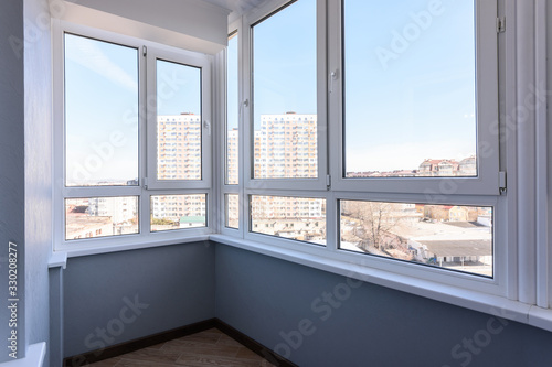 Vászonkép Glazed plastic balcony windows after renovation