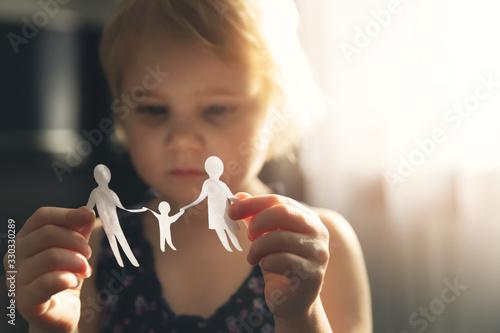 Fototapeta little girl with paper family in hands