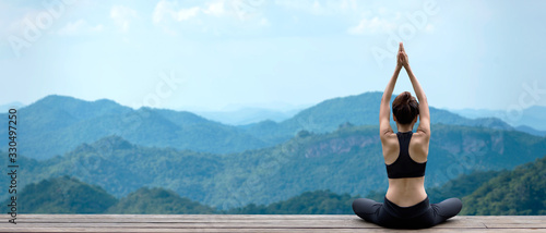 Lifestyle woman yoga exercise and pose for healthy life. Young girl or people pose balance body vital zen and meditation for workout nature mountain background in morning day. Copy space for banner.