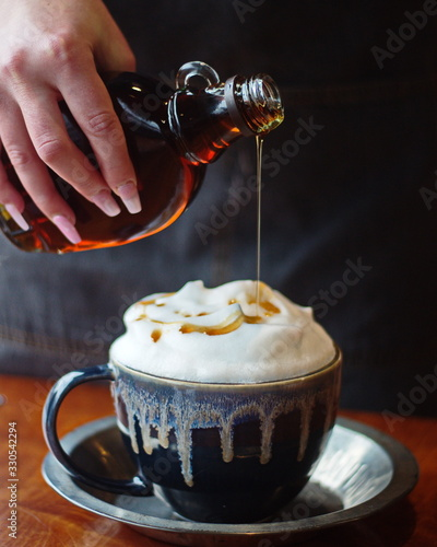 Tablou Canvas Latte hot drink topped with maple syrup at a local cafe in Ontario, Canada
