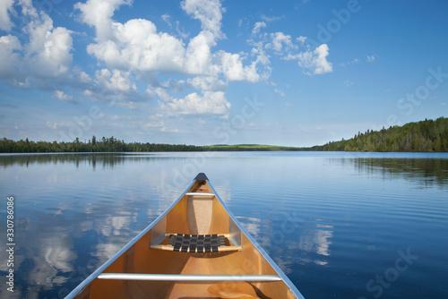 Canoe on calm northern Minnesota lake in the morning Fototapeta