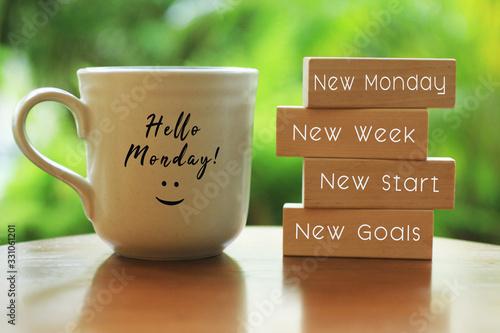 Valokuvatapetti Hello Monday concept with inspirational quote on wooden blocks - New Monday