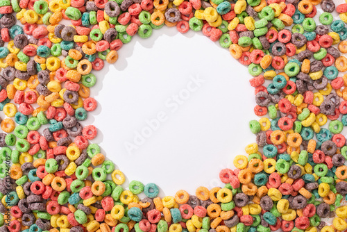 Canvas Print top view of bright multicolored breakfast cereal arranged in round frame on whit