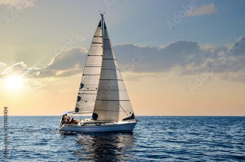 Wallpaper Mural close-up sailboat sailing under a beautiful sunset