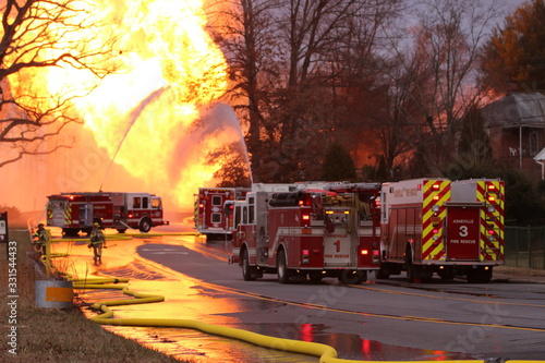 Fototapeta Multiple fire engines are use to attempt to control a major gas line rupture and fire