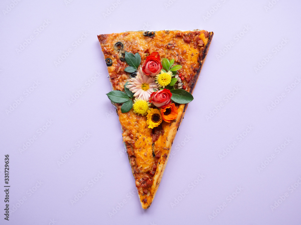 Slice of pizza with spring flowers on it <span>plik: #331729636 | autor: hbrh</span>