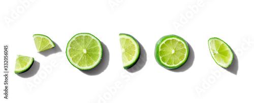 Fotografia Fresh green limes overhead view - flat lay