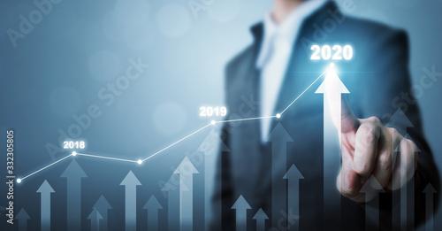Obraz na płótnie Business development to success and growing growth year 2020 concept, Businessma