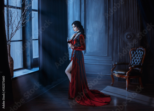 Tablou Canvas Beautiful young sexy woman vampire in medieval dark castle