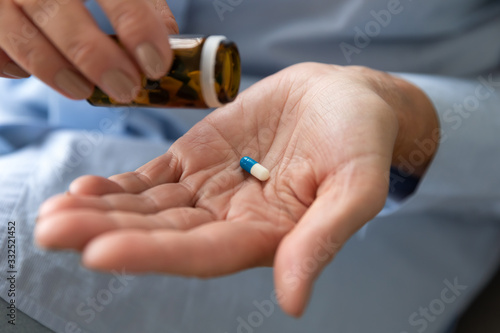 Wallpaper Mural Close up of elderly woman hold hand with drug taking daily dose of medications a