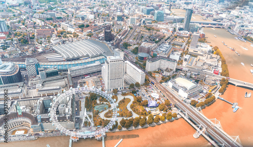 Fotografie, Obraz Helicopter view of London Thames and city buildings  in Autumn