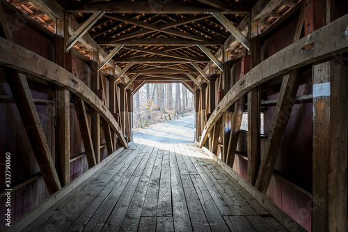 Photo Looking down the inside of a covered wooden bridge in rural Lancaster County, Pennsylvania, USA