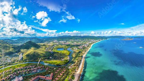 Valokuva Coastal Scenery of Luxury Resort with Villas, Yacht Marina and Recreational Beach at Yalong Bay, Sanya, Hainan Island, a Tourism Destination for Summer Vacation in China, with Tropical Climate