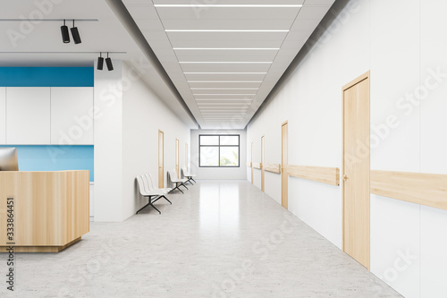Hospital corridor with chairs and reception Poster Mural XXL