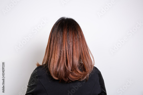Stampa su Tela Close up of smooth red-haired woman shot from behind isolated on wite background