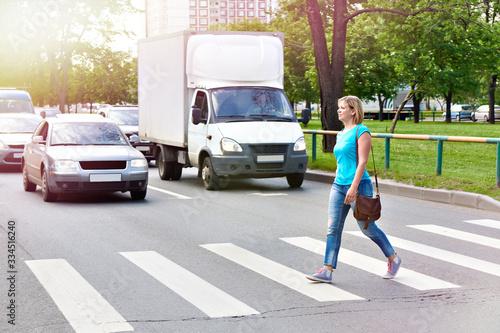 Woman crossing street at crosswalk Poster Mural XXL