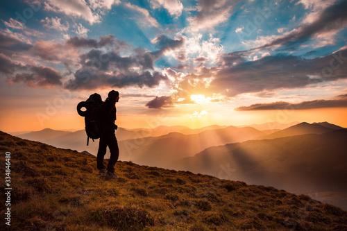 Fotografie, Tablou Hiking trough epic mountain landscape with a big backpack, exploring and feeling