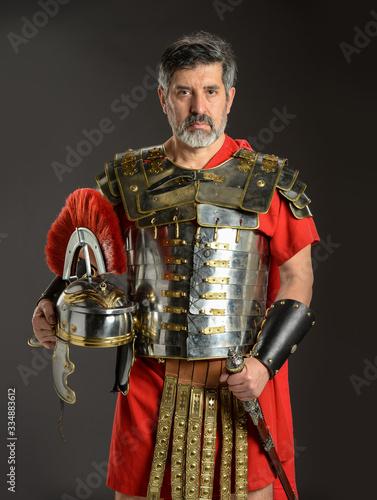 Fotografie, Obraz Roman soldier posing holding his helmet