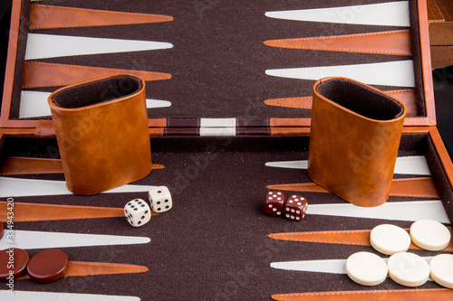 Tela backgammon game with board pieces and dice