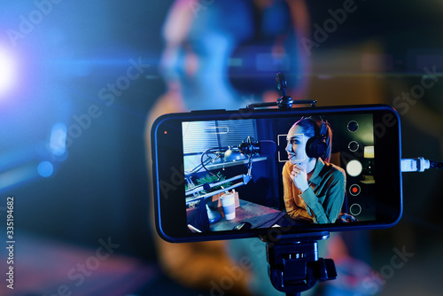 Young woman streaming a live video Fototapeta