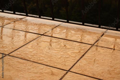 Wet tiles on a balcony Fotobehang