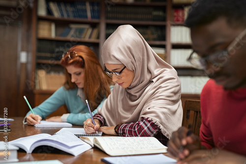 Wallpaper Mural Muslim young woman studying with classmates