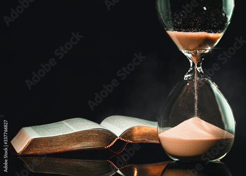 Wallpaper Mural Hourglass and Holy Bible
