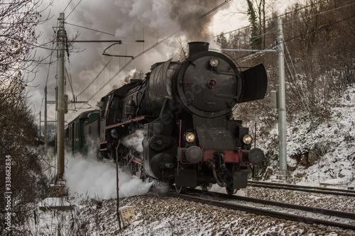 Obraz na plátně Front of the european style war train steam locomotive