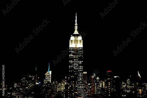 Fotografia, Obraz Illuminated Empire State Building With Cityscape At Night