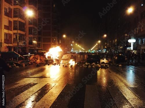 Obraz na plátně Riot On Illuminated Street At Night