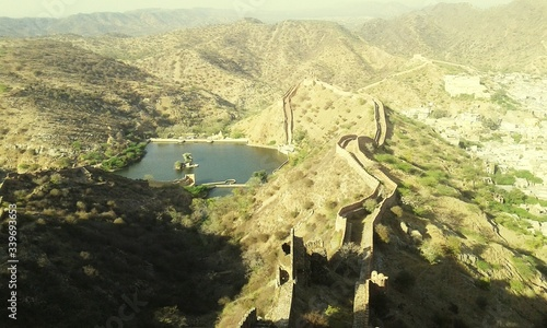 Fotografie, Obraz Scenic View Of Lake Amidst Mountains With Great Wall Of China