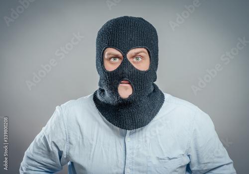 Wallpaper Mural Face of a angry burglar wearing a black ski mask or balaclava