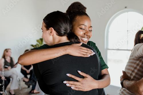 Fotografiet Women hugging each other