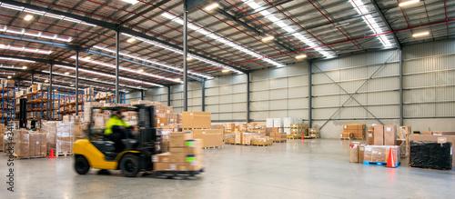 Fotografia Forklift working at logistics warehouse