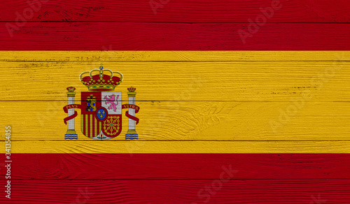 Photo Spain flag on a wooden texture