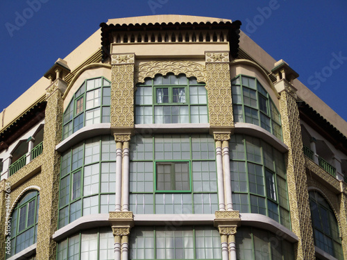 Revival building with glazed facade in the city of Melilla. Spain.