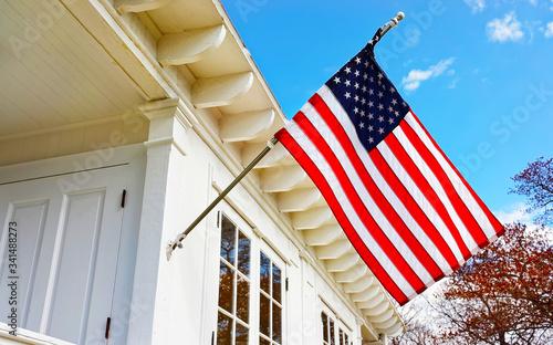 Valokuva American flag on Sandy Hook Light house museum reflex
